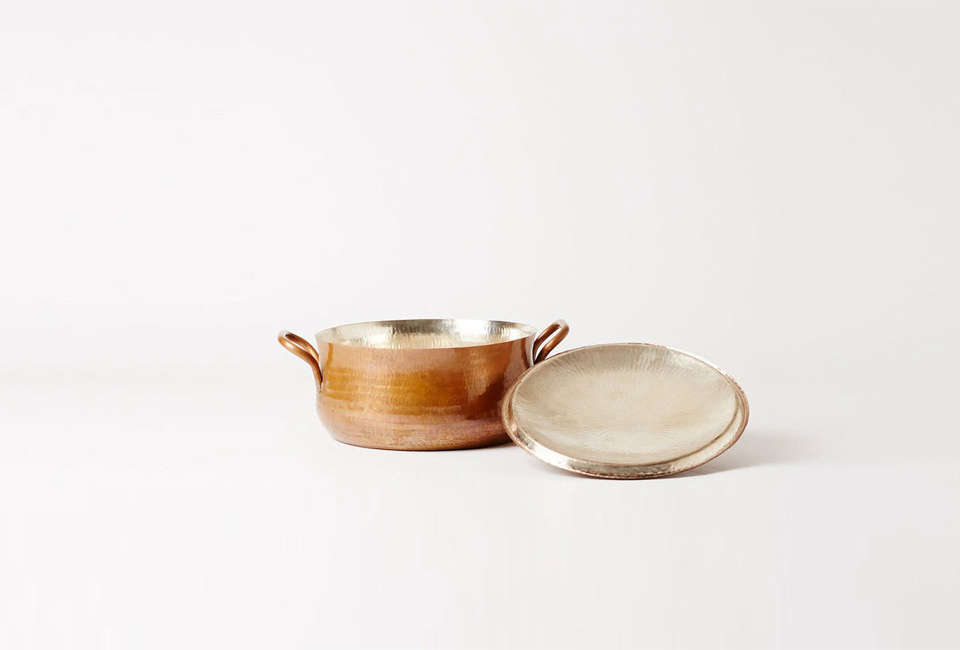 Steal This Look A ScandiStyle Kitchen in a Canadian Cabin TheJurgen Lehl Round Copper Pan is \$775 CAD (\$594 USD) at Mjölk.