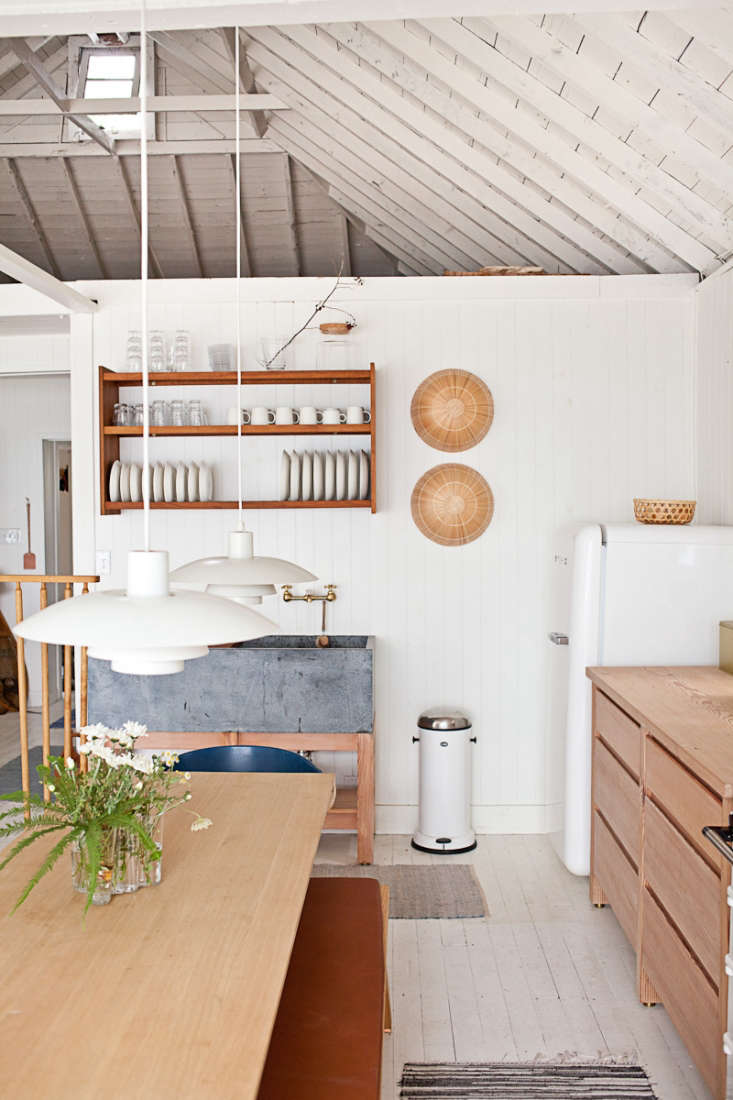 The floors inMjölk's Renovated Scandi-Style Cabin on a Lakeare also painted white, these inBenjamin Moore&#8