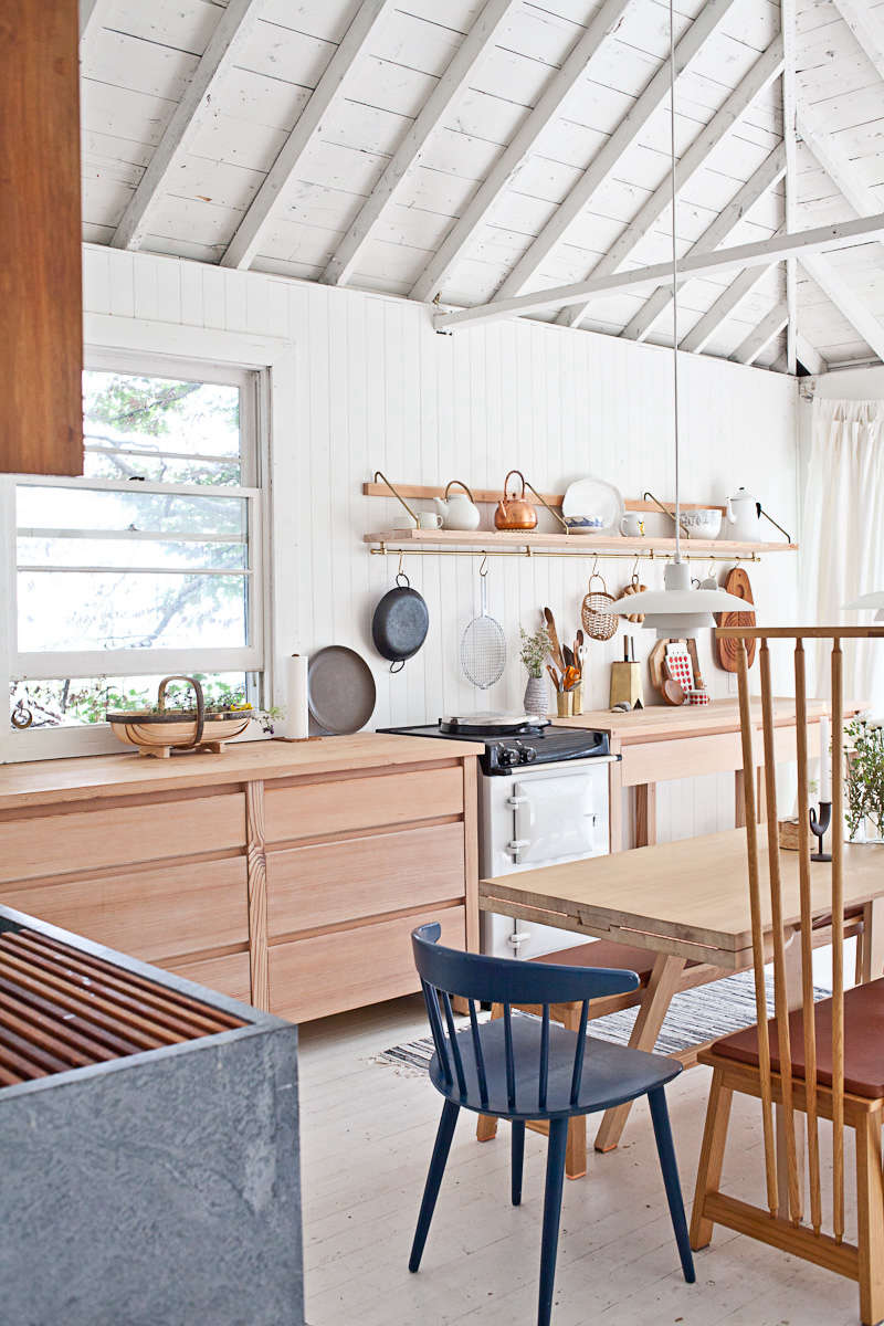 Steal This Look A ScandiStyle Kitchen in a Canadian Cabin Studio Junction designed the cabinets and countertops with Carolina pine finished in a lye wash and beeswax coating.