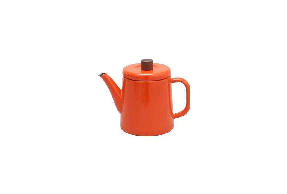 The red kettle in the kitchen is a vintageAntti Nurmesniemi kettle designed for Arabia. You can still find them via Etsy and eBay.For something similar, the Japanese Noda Horo Enamel Teapot in Orange(shown) is £58 ($77) at Labour & Wait.