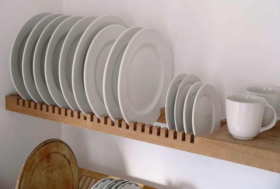 Steal This Look A ScandiStyle Kitchen in a Canadian Cabin A custom shelf by Peter Henderson Furniture features slots for storing plates. Go to Peter Henderson for more information. See more in our post \10 Easy Pieces: Wall Mounted Plate Racks.