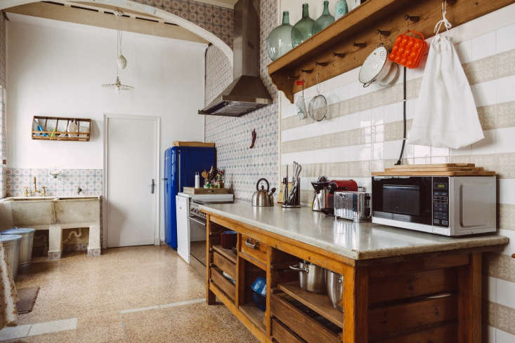 A striking blue fridge in the corner of a kitchen on the Spanish island of Menorca; seeKitchen of the Week: Embracing the Old with Quintana Partners.