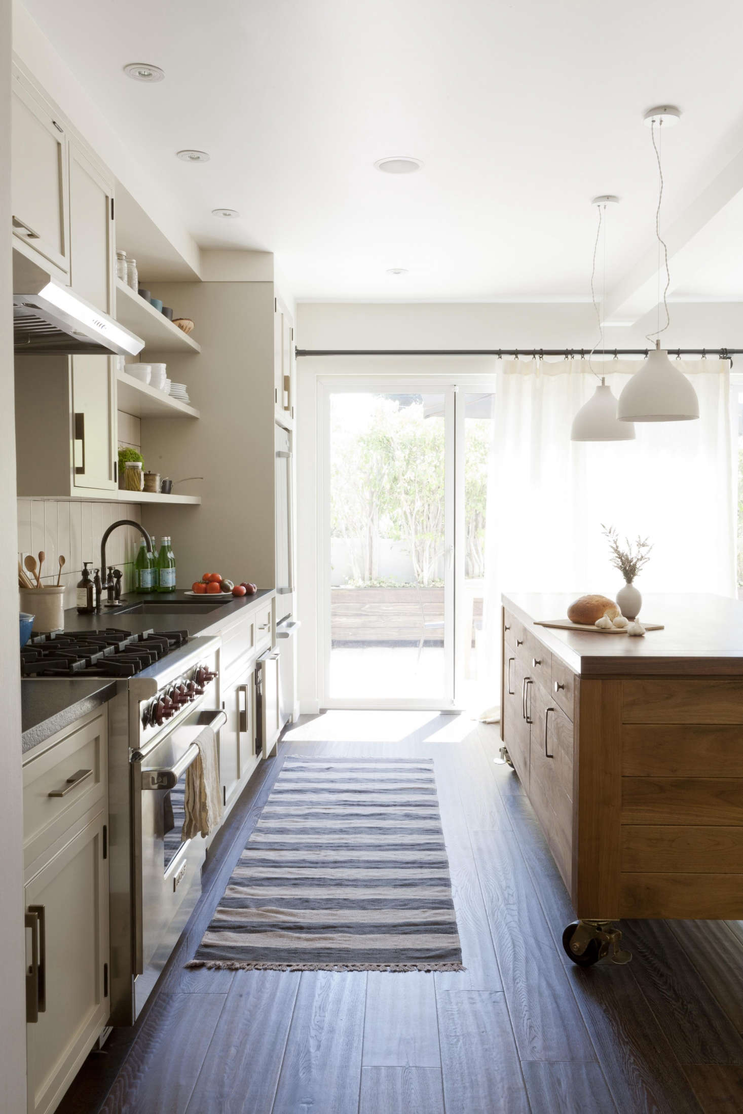 Semi-sheer linen panels add privacy, or pull back to reveal an outdoor courtyard inKitchen of the Week: A Striking Before/After in Venice, California.