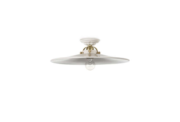 theceiling light ceramic from thomas hoof has a solid brass shade holder;� 15