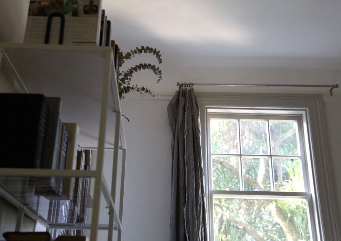 diy gray linen curtains hung on a nickel rod with clips in an office 16