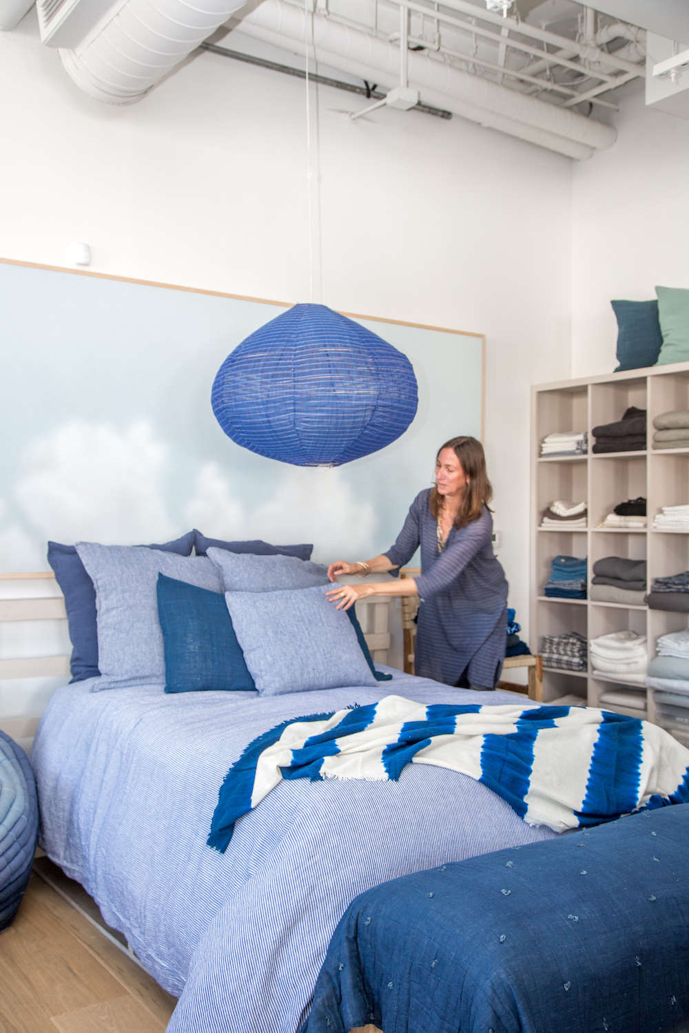 Modern blue bedding, light and dark blue, with fabric covered light fixture