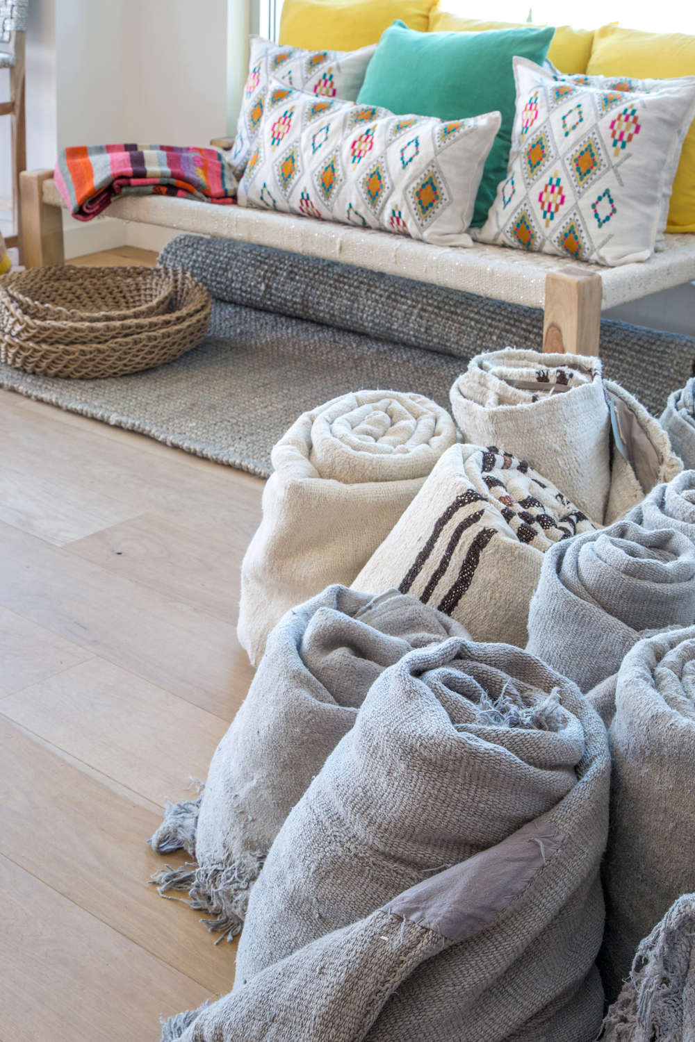 Global eclectic rugs and pillows in Lost & Found modern home store in Santa Monica, Los Angeles