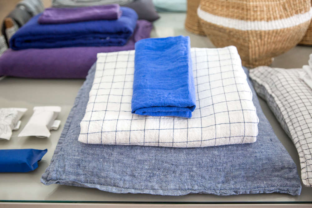 Blue linen pillow, duvet, and napkin in Lost & Found modern home store in Santa Monica, Los Angeles