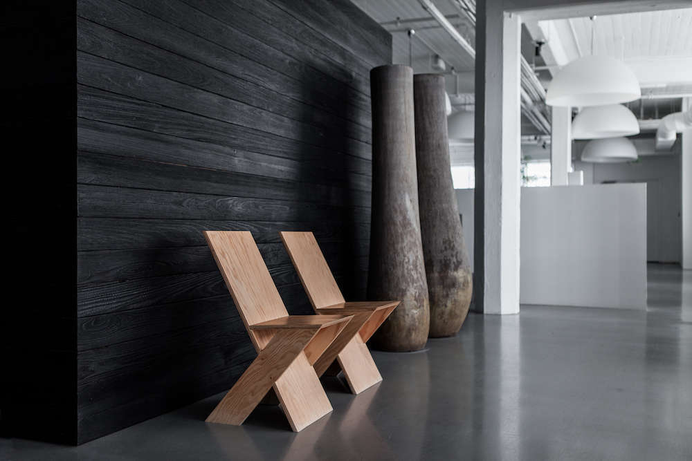 Shou Sugi Ban Wall with Modern Chairs