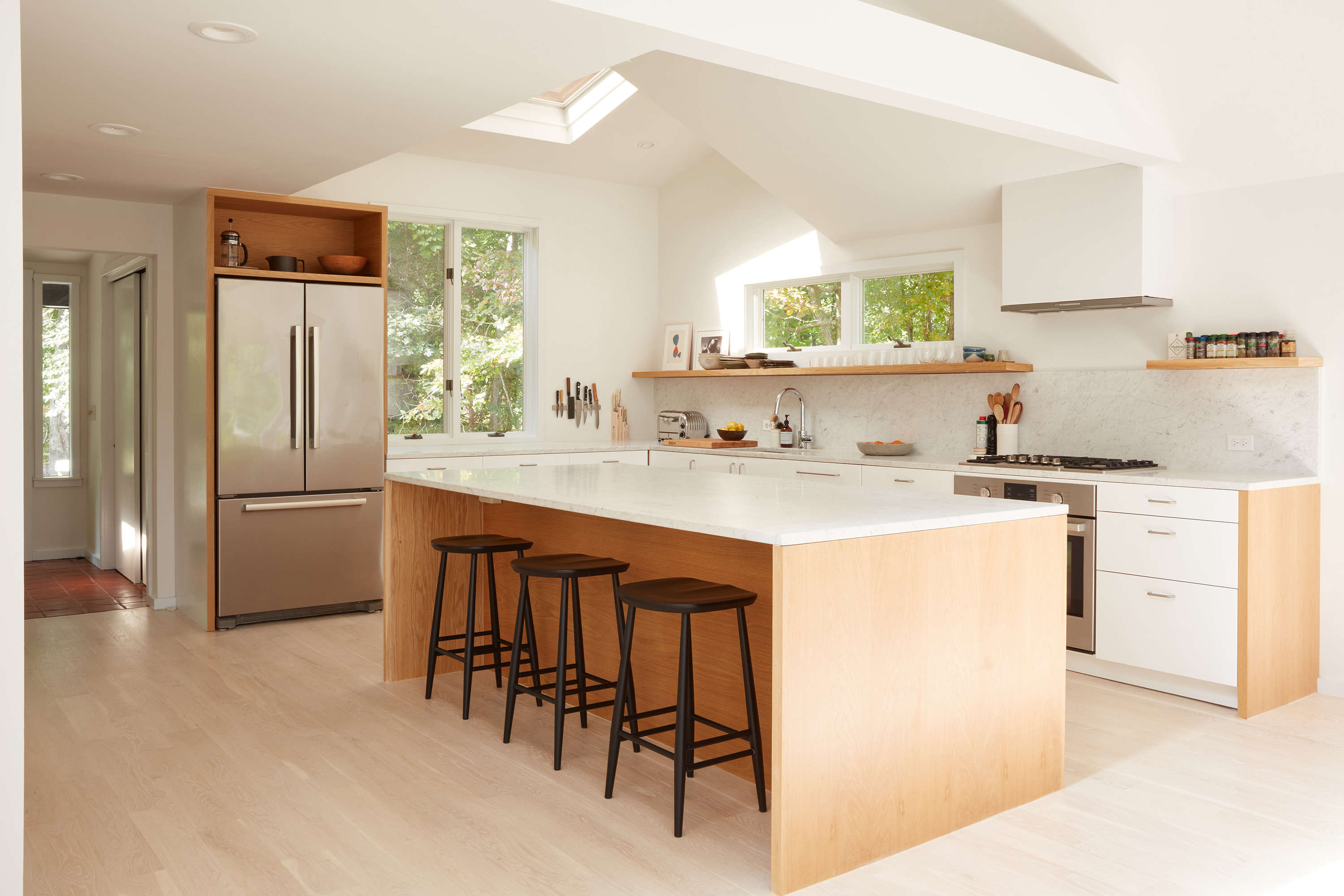In addition to removing the kitchen wall, Jones and team lofted the ceiling. (The skylight was original—the ceilingwas &#8