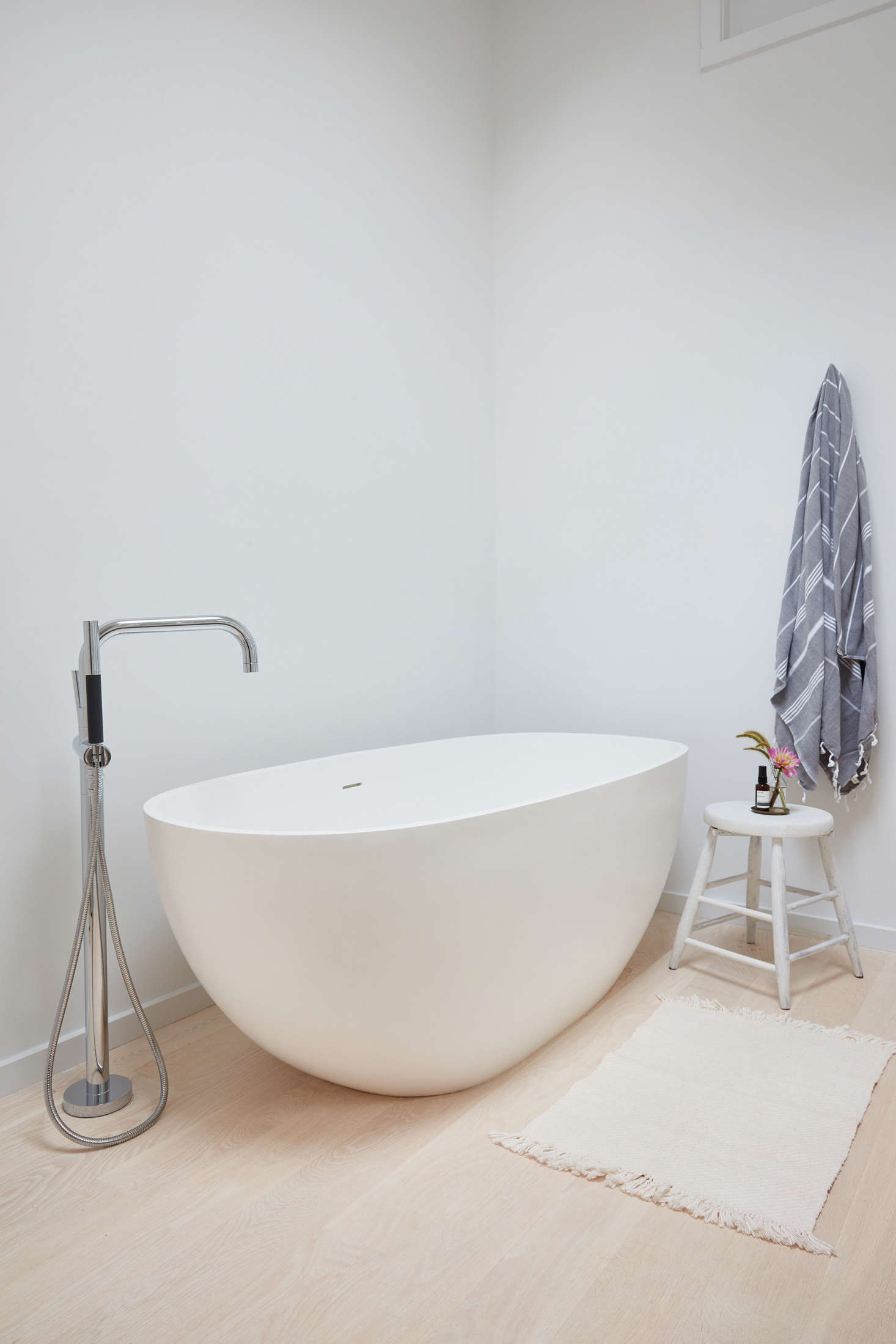 Also in the master bathroom, the ideal rejuvenation spot: a freestanding soaking tub from Signature Hardware is paired with a faucet from Kohler&#8