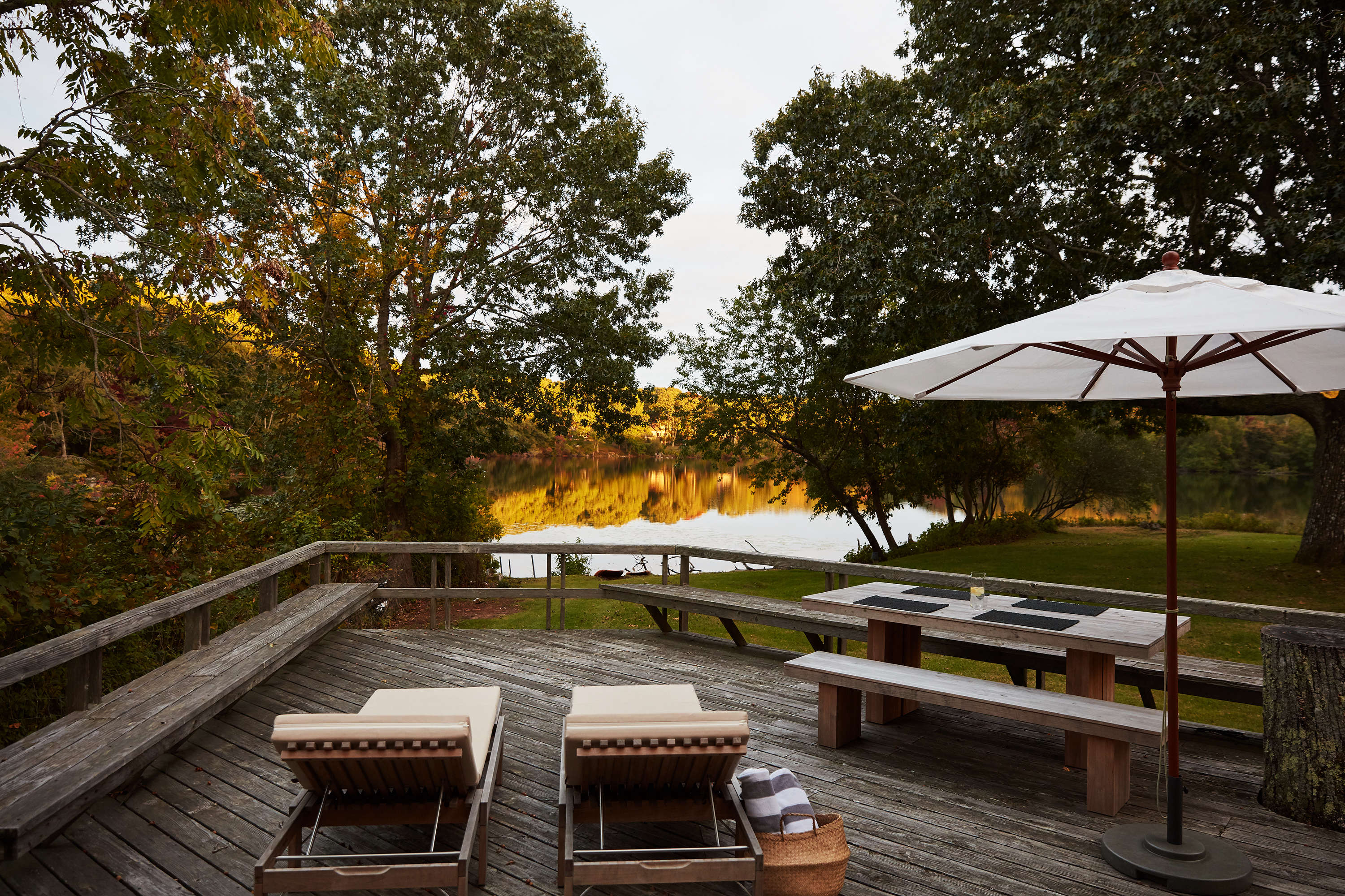 Jones kept the original weathered deck overlooking the lake, but added a two cream chaises fromSkagerak(a similar option is available here),and a Vietnamese rice basket, ideal for carrying lakeside essentials, from Lantern Moon.