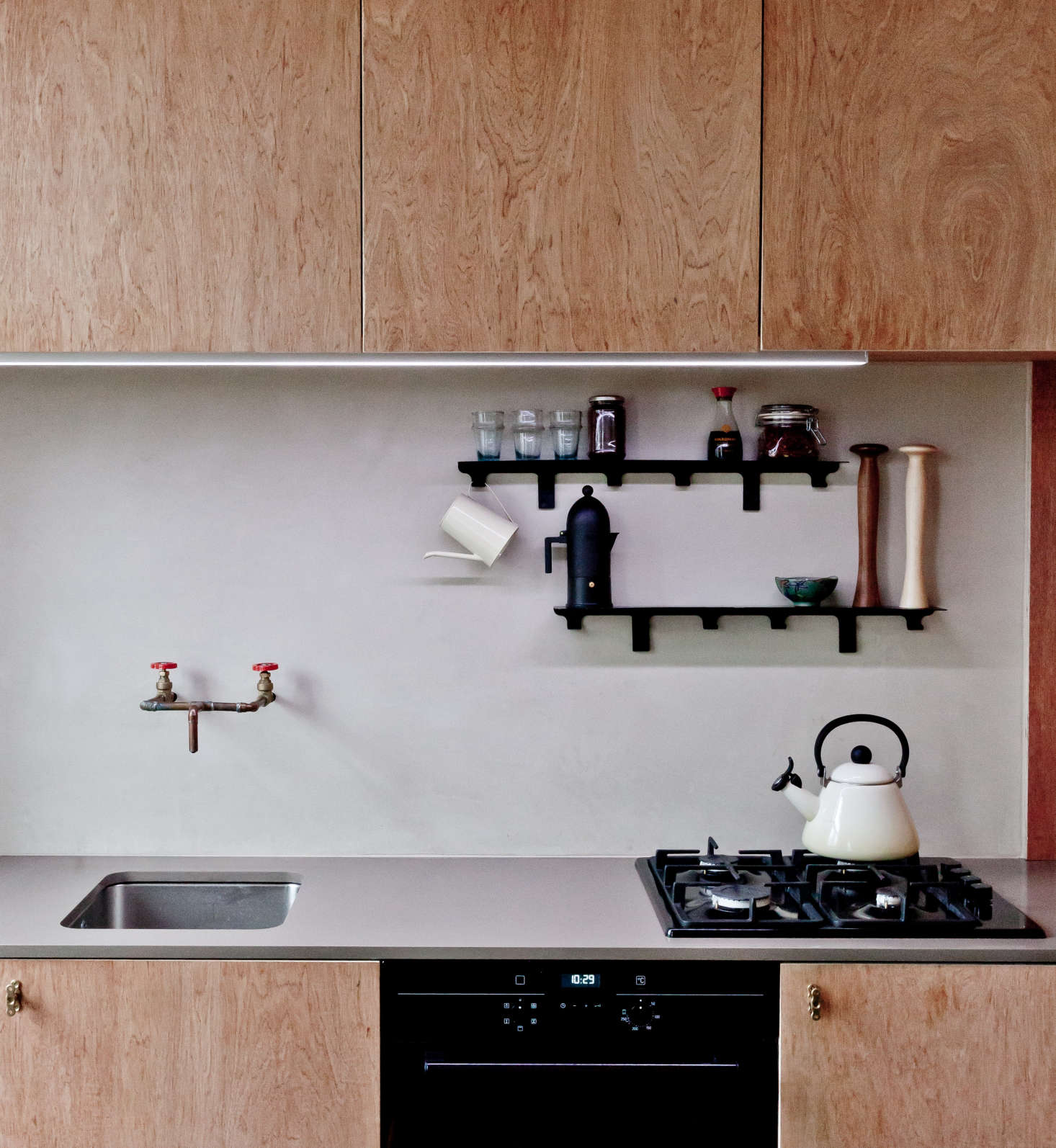 "When his client requested a simple, affordable kitchen in her petite North London flat, architect Simon Astridge chose a tadelakt backsplash, which ""has a depth and feel to it that matches the tones of the plywood and the worktop,"" he said. See the rest in Kitchen of the Week: An Artful, Honest Kitchen in North London. Photograph by Nicholas Worley, courtesy of Simon Astridge Architecture Workshop."