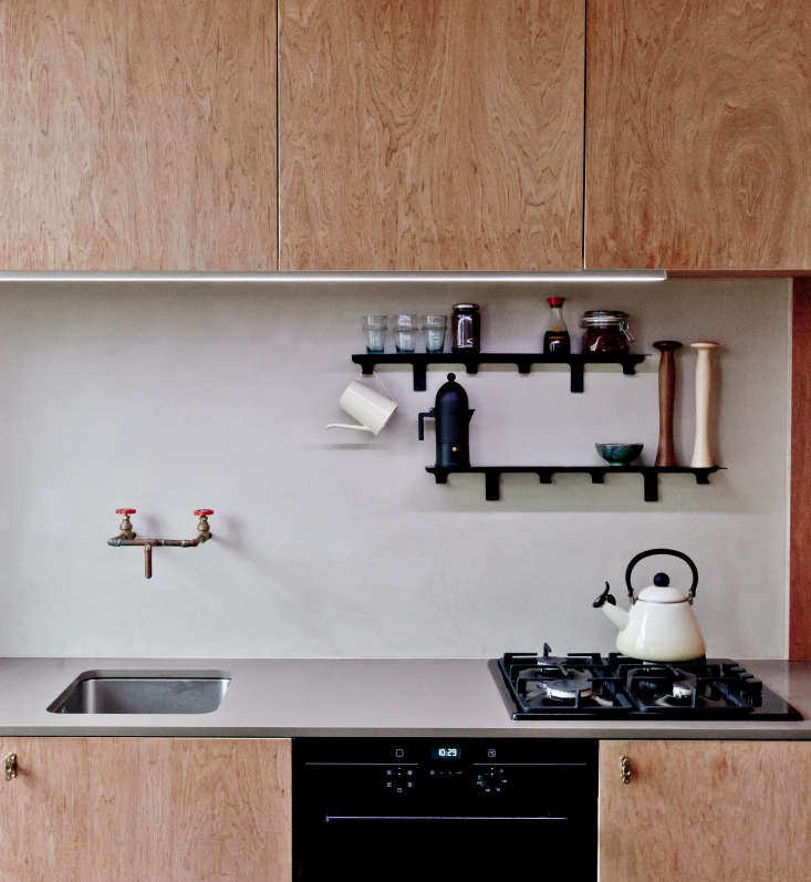 """When his client requested asimple, affordable kitchen in her petite North London flat, architectSimon Astridge chose a tadelakt backsplash, which """"has a depth and feel to it that matches the tones of the plywood and the worktop,"""" he said. See the rest in Kitchen of the Week: An Artful, Honest Kitchen in North London. Photograph by Nicholas Worley, courtesy of Simon Astridge Architecture Workshop."""