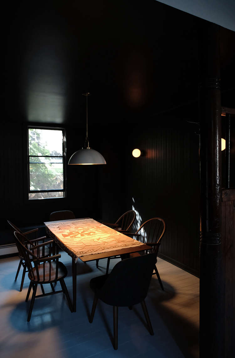 Before and After A Tuxedo Park Carriage House Gets an Update in Black and White black painted dining room space exploration