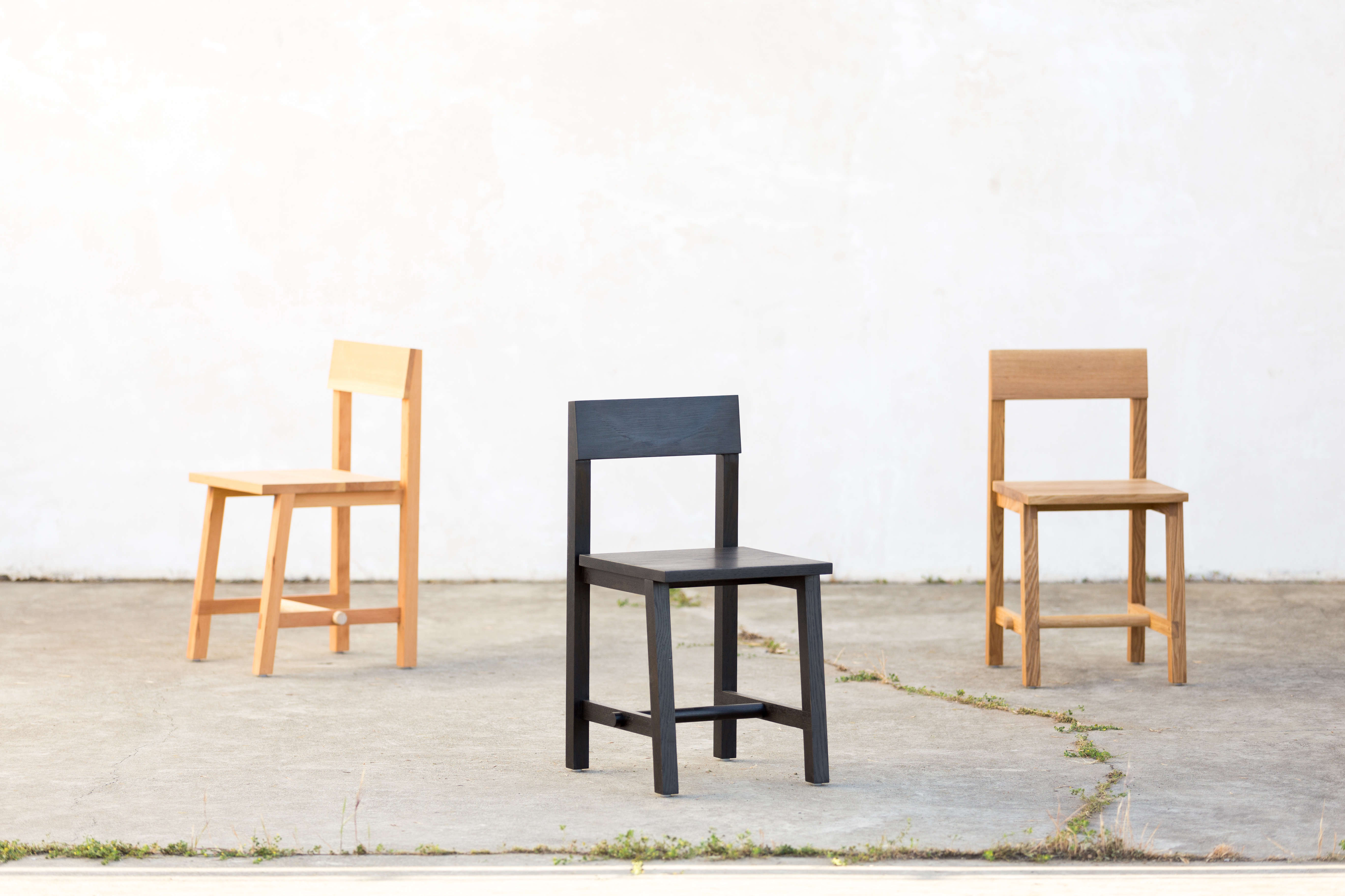 Dowel Dining Chairs in Douglas fir, blackened oak, and natural white oak.