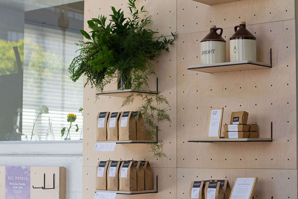 Front Cafe Peg Boards with Plants by Yvonne Mouser, Photo by Lisa Mishima