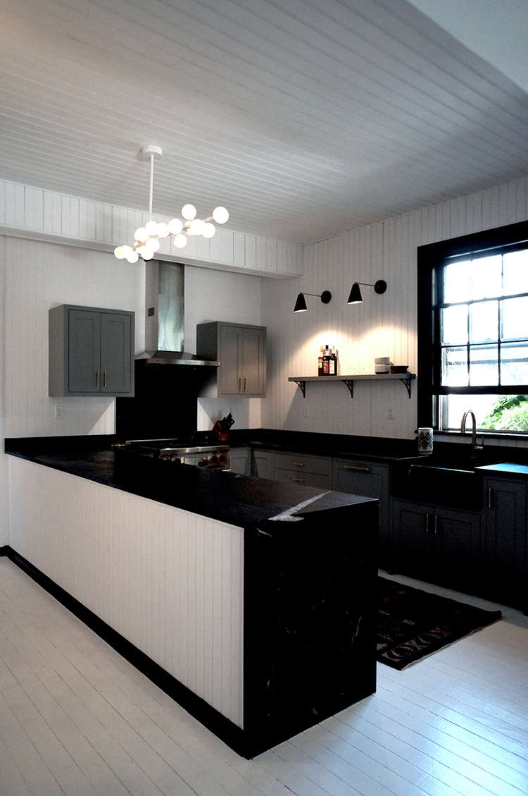 Before and After A Tuxedo Park Carriage House Gets an Update in Black and White kitchen with black and white space exploration