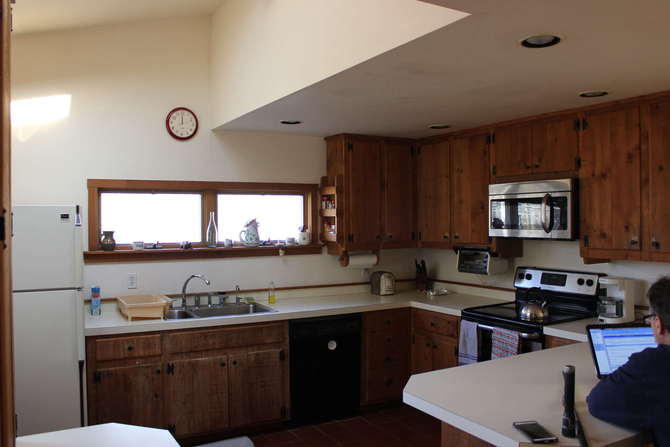 The kitchen, as it was. Jones opened up the enclosed spaceand replaced the heavy, dark cabinetry.
