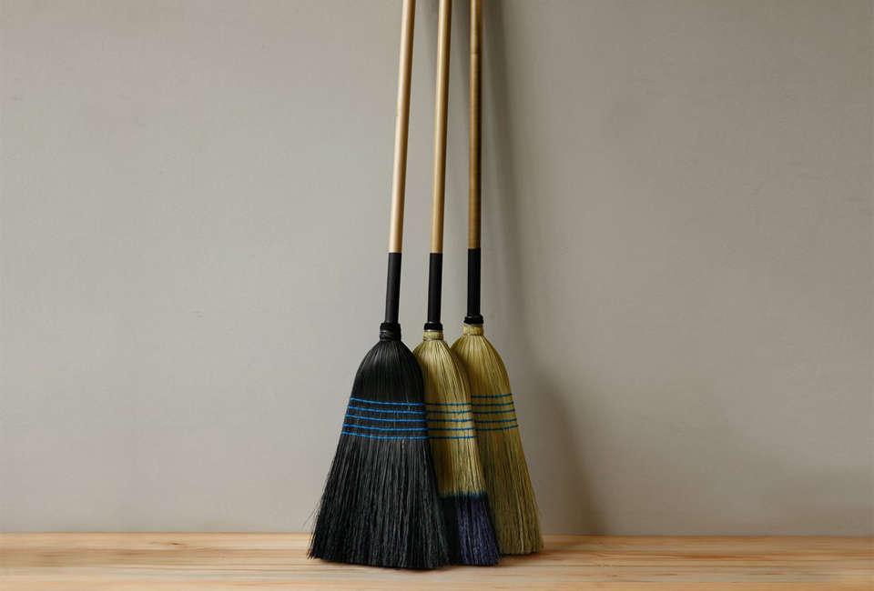 These three corn huskBarn Brooms, in black, &#8