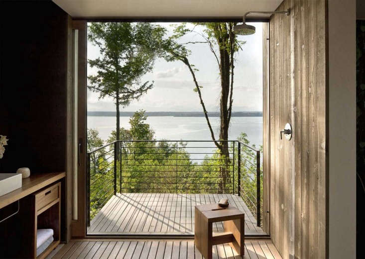 A bathroom with a view, via A Puget Sound Cabin that Rests Lightly on the Landscape.