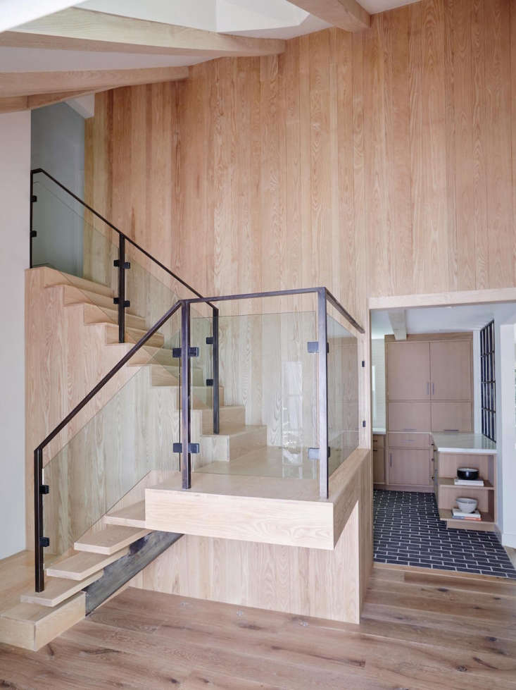 a staircase made of ash wood, steel, and glass in a beverly hills renovation by 15