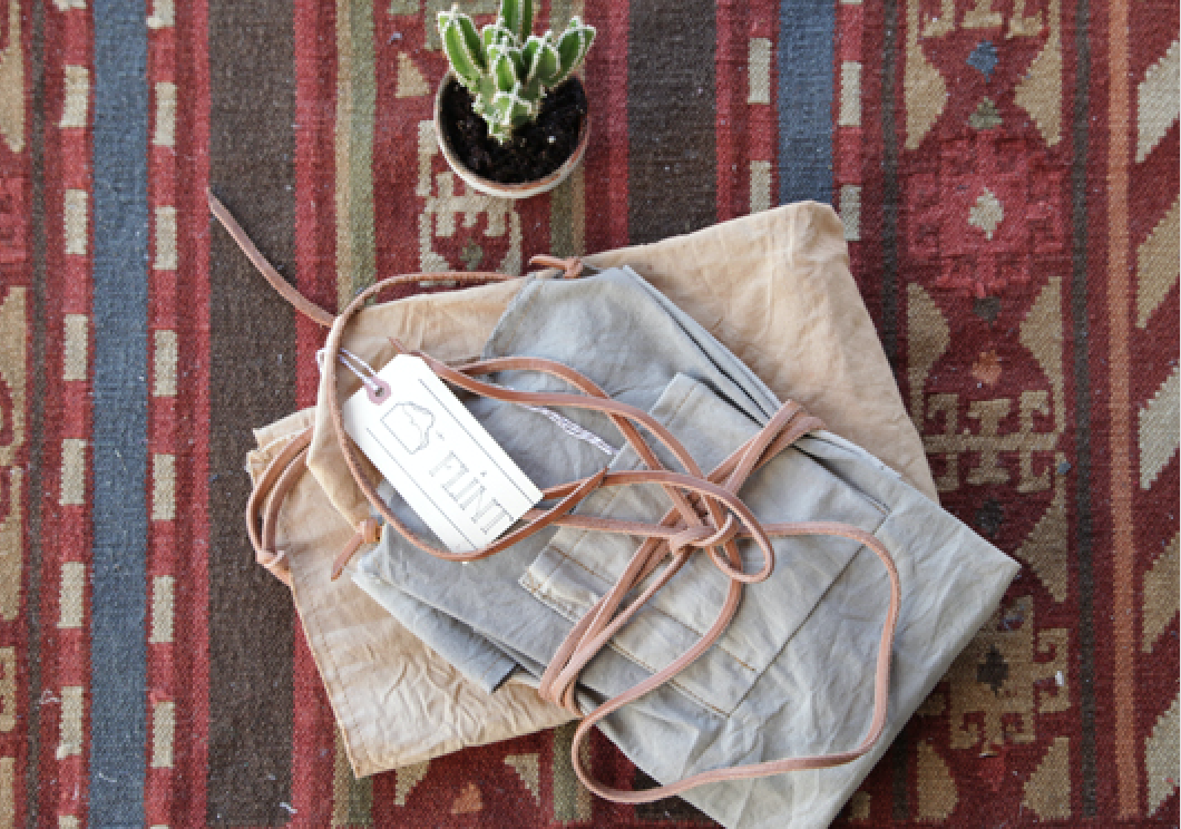 stack of canvas aprons by matt katsaros via straw and gold on remodelista 12