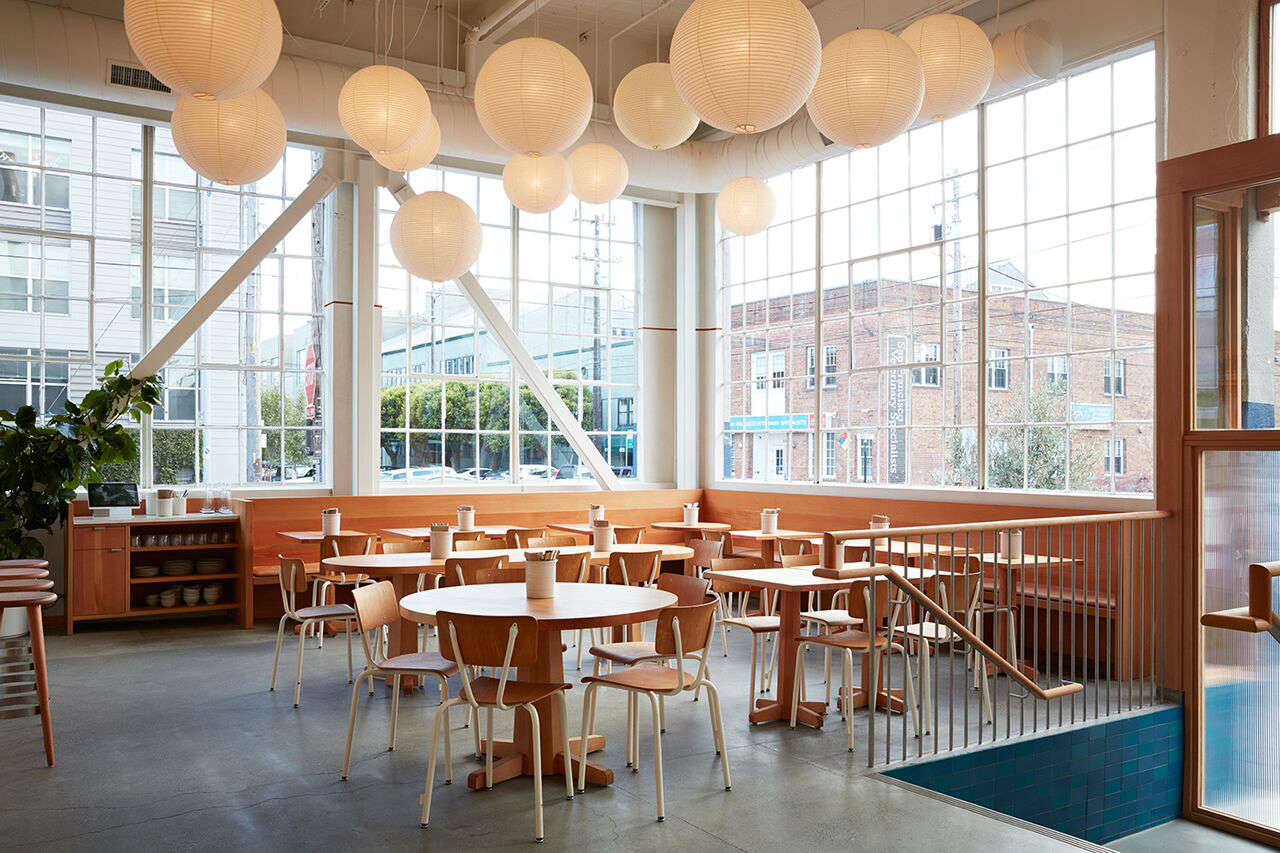 Uniform cream powder-coated chairs make for a pared-back look in Tartine Manufactory in San Francisco. For more, see7 Ideas to Steal from the Manufactory in SF by Commune Design.