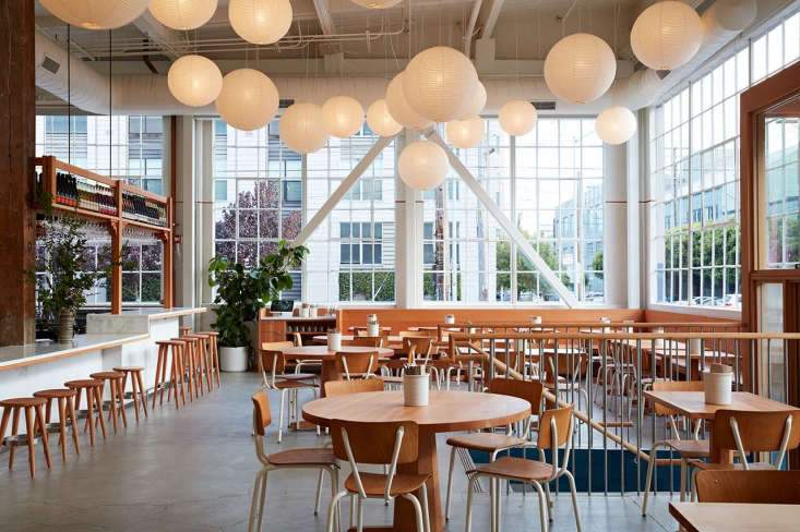 A galaxy of trend-resistent Noguchi lanterns illuminates the dining area of Manufactory. Photograph by Mariko Reed, from 7 Ideas to Steal from the Manufactory in SF by Commune Design.