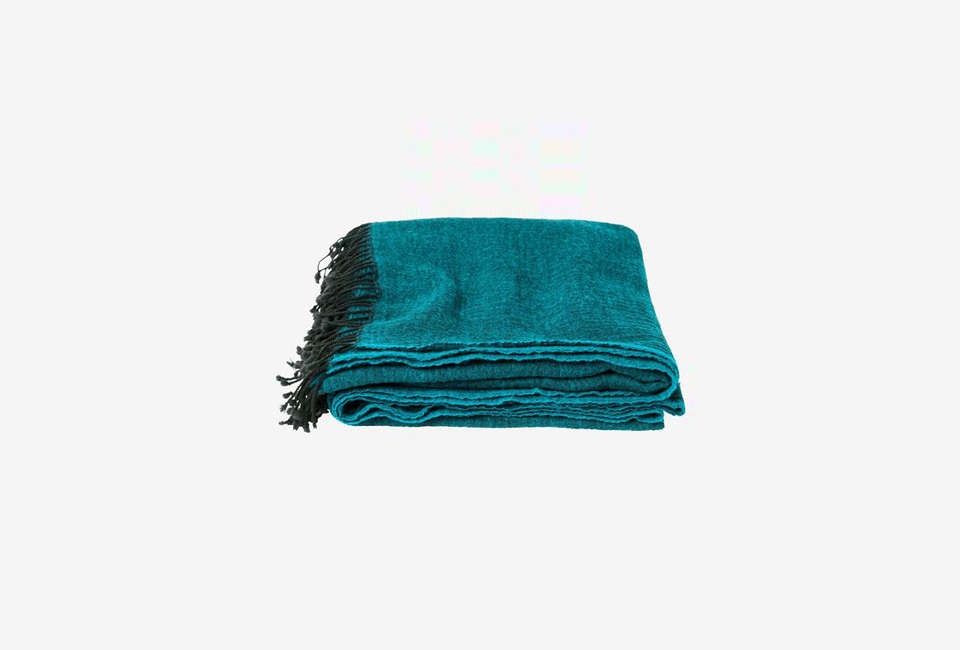 The Washed Wool Throw in Petrol Blue merino wool is £5 ($5.46) at Toast in the UK.