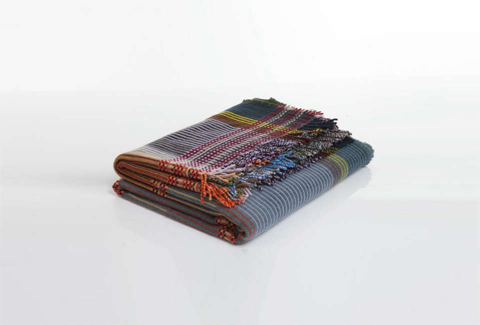 The handmade wool Wallace & Sewell Peel Throw Blanket is $475 for the small size at Lost & Found.