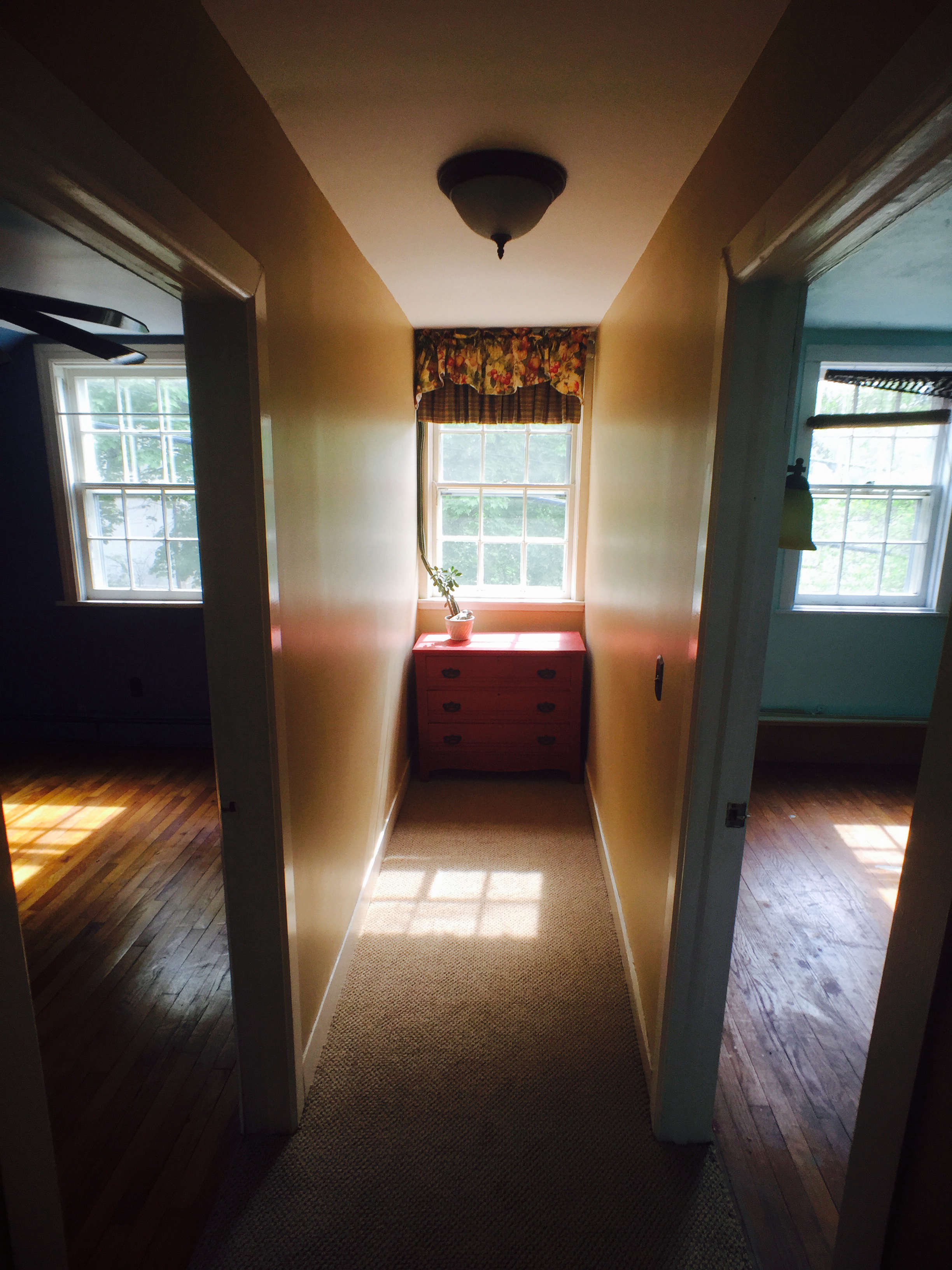 Before and After A Tuxedo Park Carriage House Gets an Update in Black and White Before photo old hallway bedrooms needs remodel
