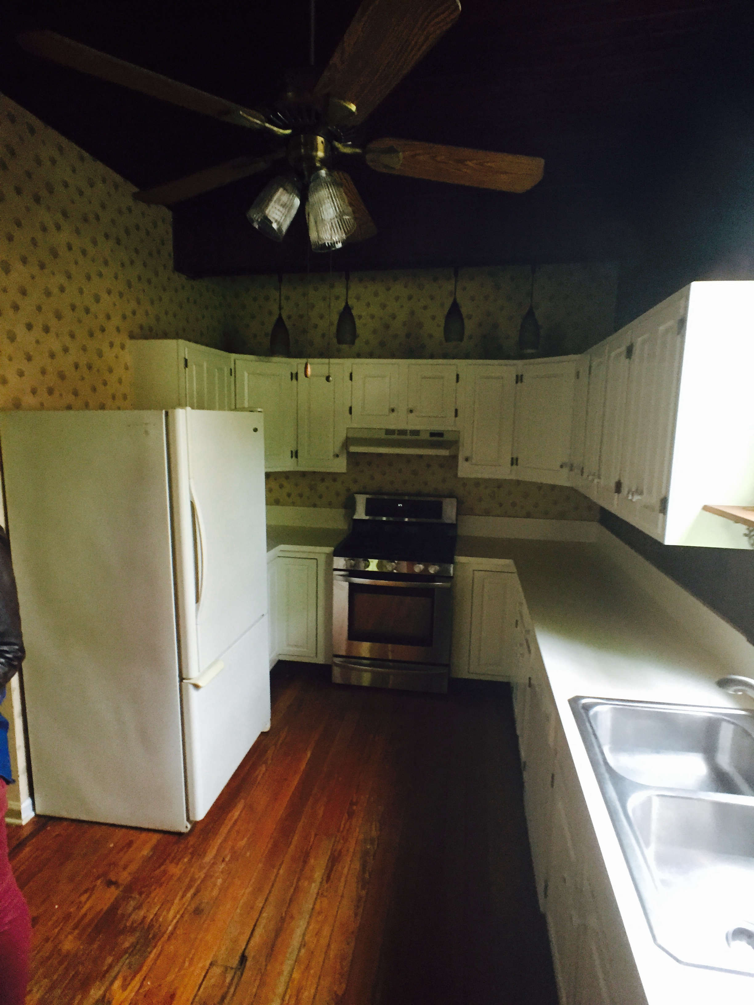 Before and After A Tuxedo Park Carriage House Gets an Update in Black and White Before photo old white kitchen needs remodel