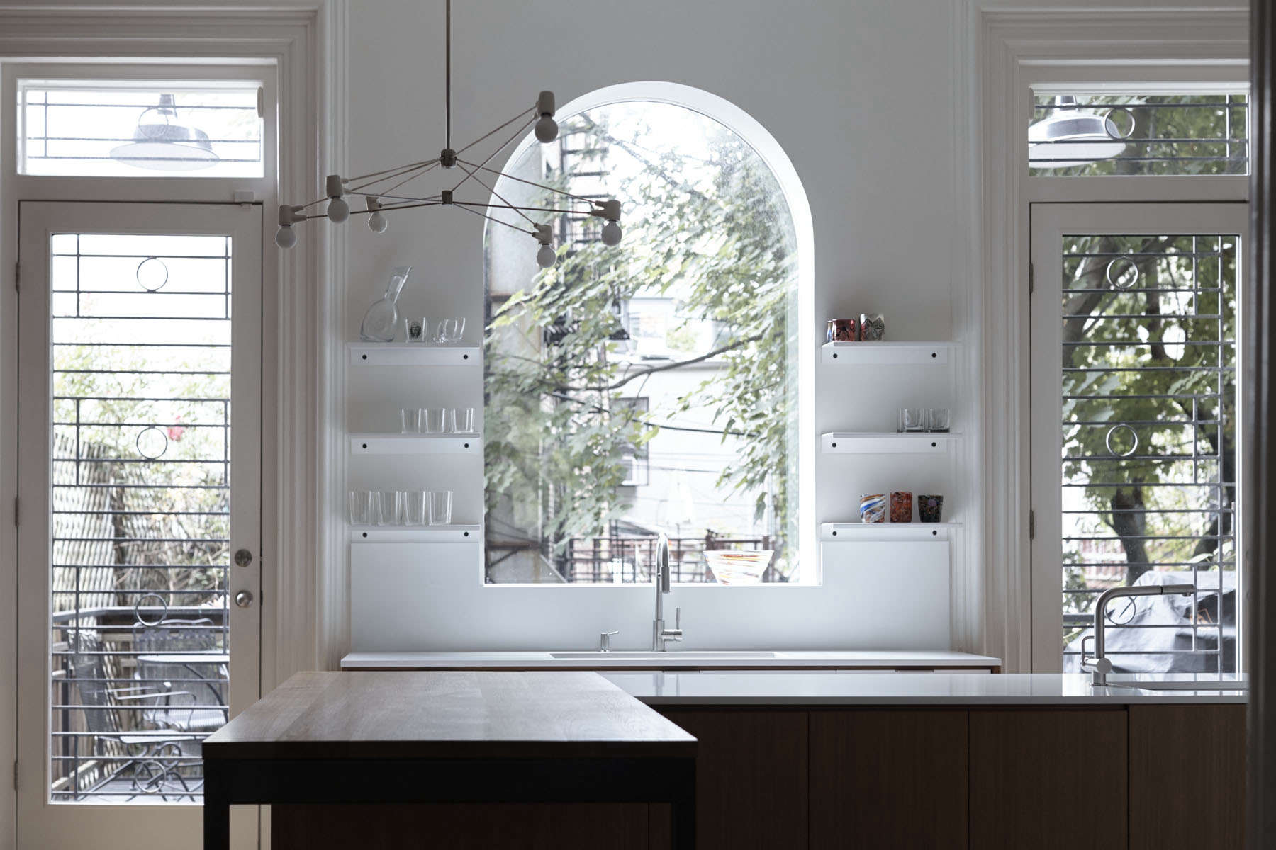 the existing arched window over the sink was opened upto create a big view of 11