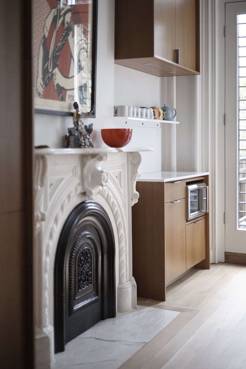 In the back parlor turned kitchen of ath-century Brooklyn townhouse, architectShauna McManushidthe microwave into the coffee counter. See Kitchen of the Week: A Something Old, Something New Kitchen in Brooklyn.