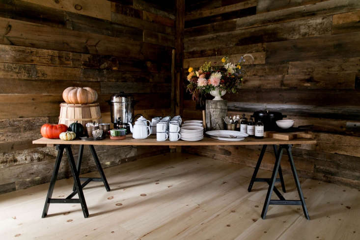 For harvest dinner parties in a barn in the Hudson Valley, Ikea's Oddvald solid wood trestles and a plank of wood become a side table for dessert and coffee. See more in The High/Low Table: loading=