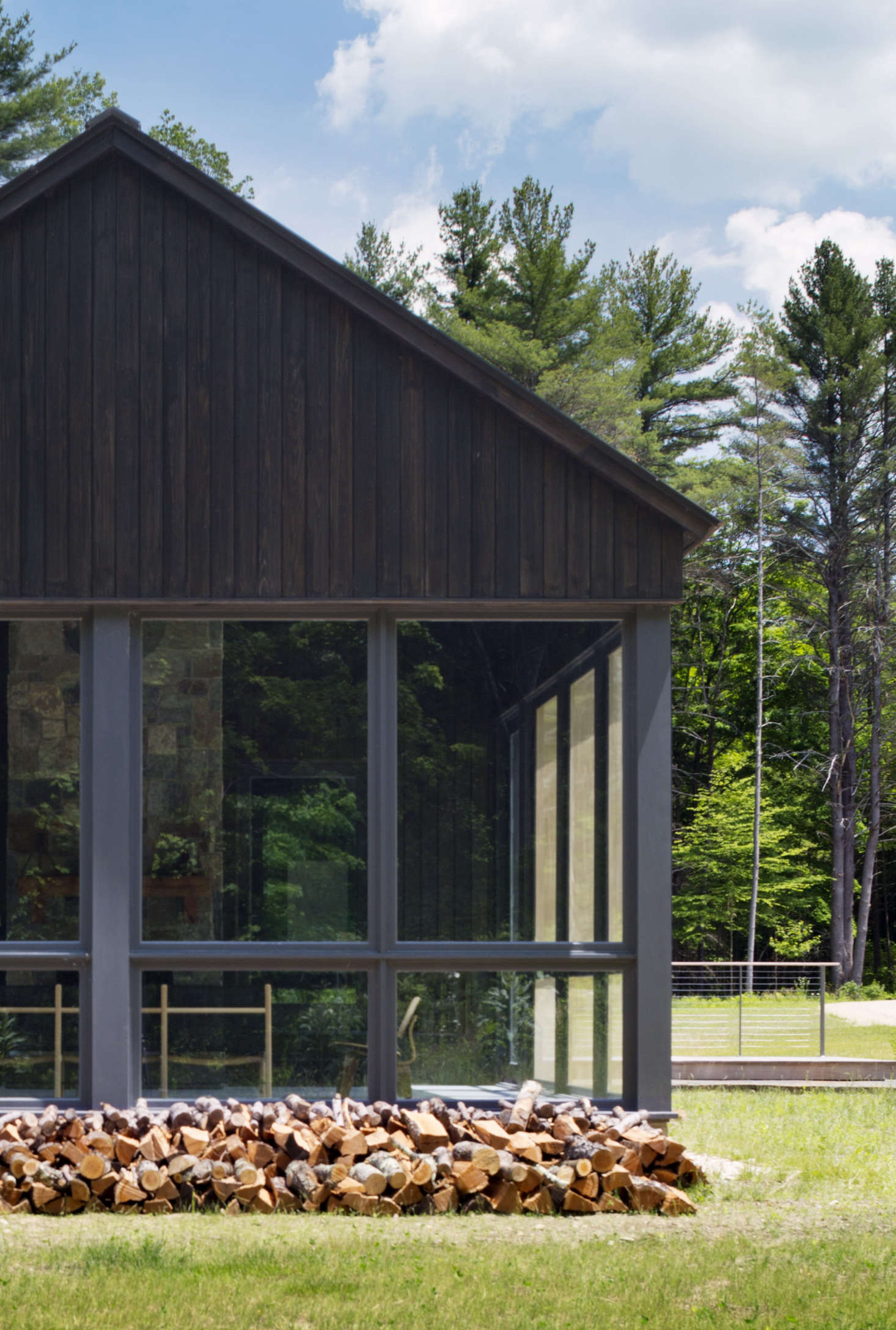 The porch (of stained cypress) at Undermountain, a barn-style house in the Berkshires by O'Neill Rose Architects