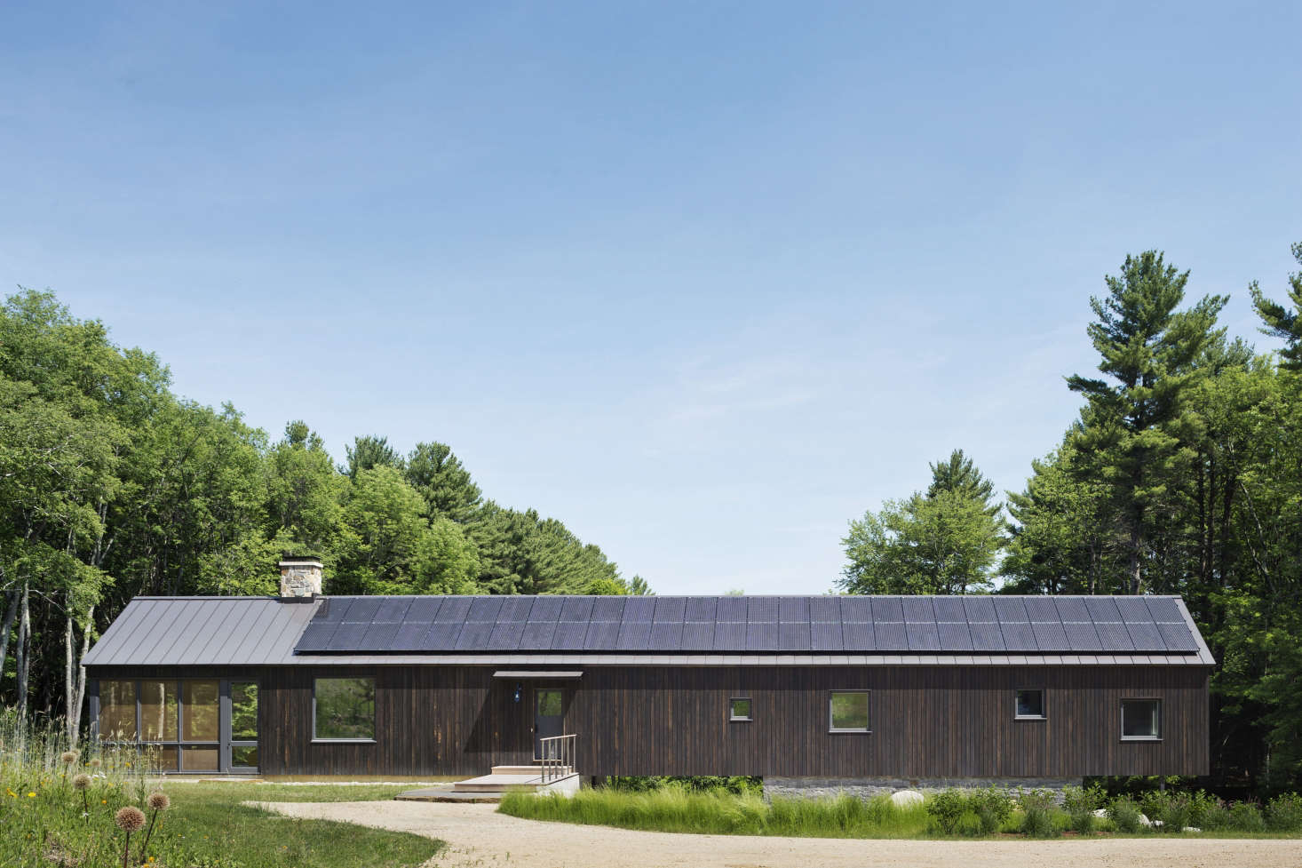 Standing seam metal roof and solar panels on Undermountain, a barn-style house in the Berkshires by O'Neill Rose Architects