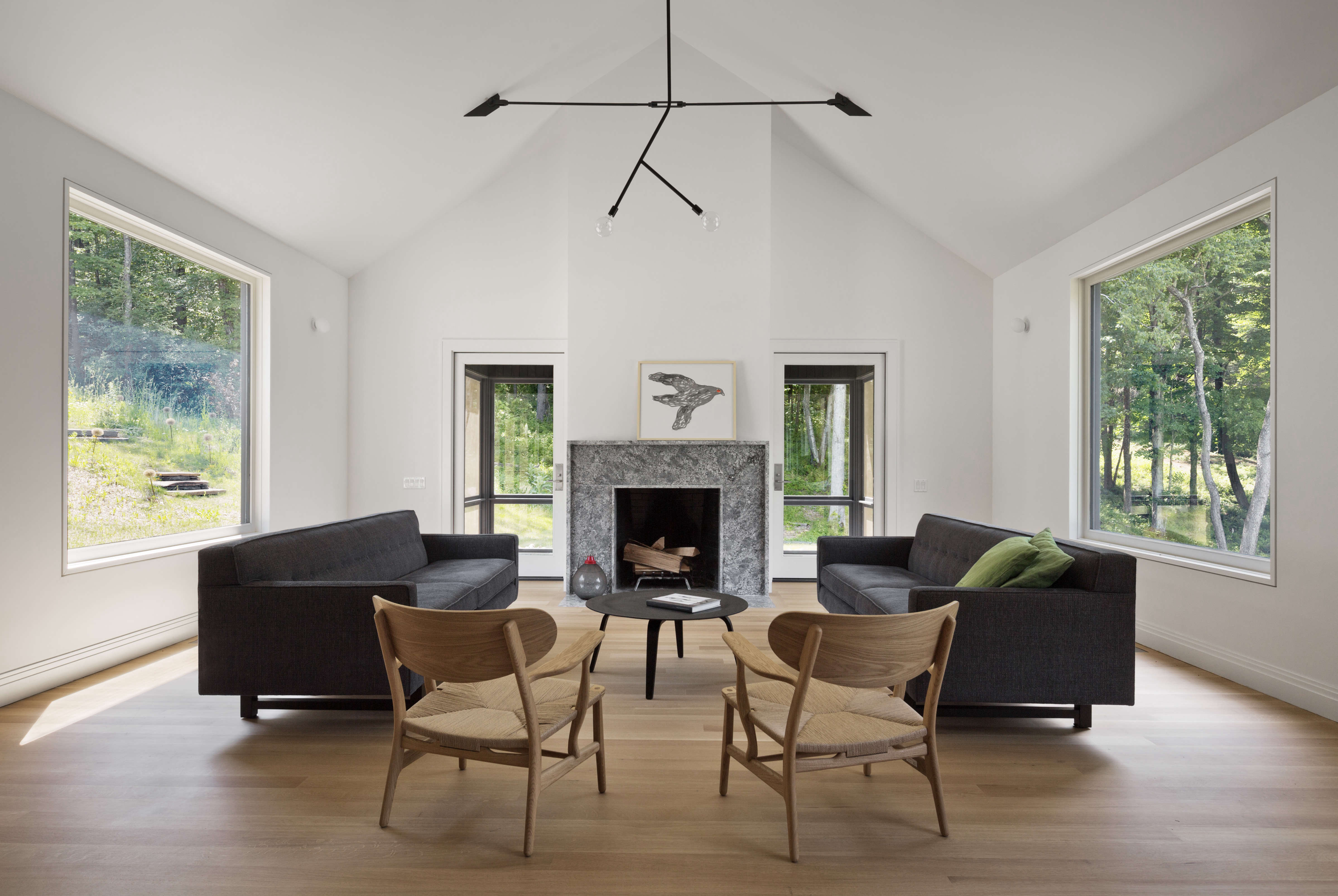 peaked ceiling living room at undermountain, a barn style house in the berkshir 12