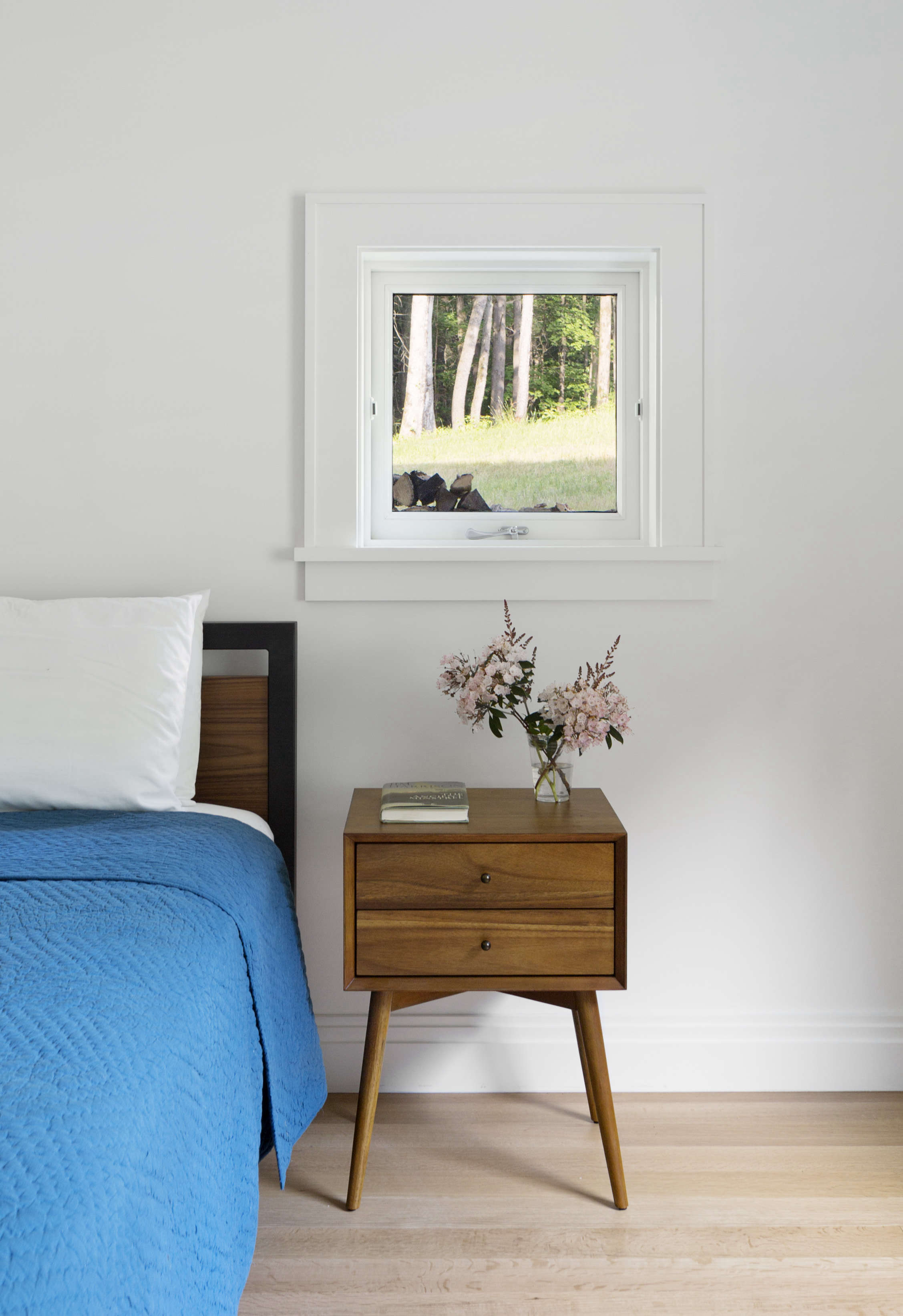 midcentury style master bedroom at undermountain, a barn style house in the ber 18