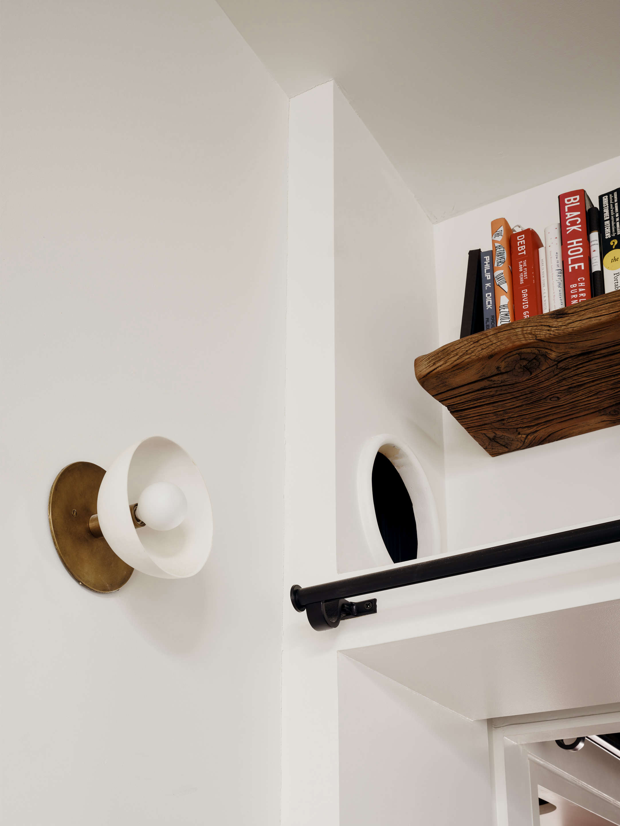 brass and white wall sconce in living room and pet travel hole general assembly