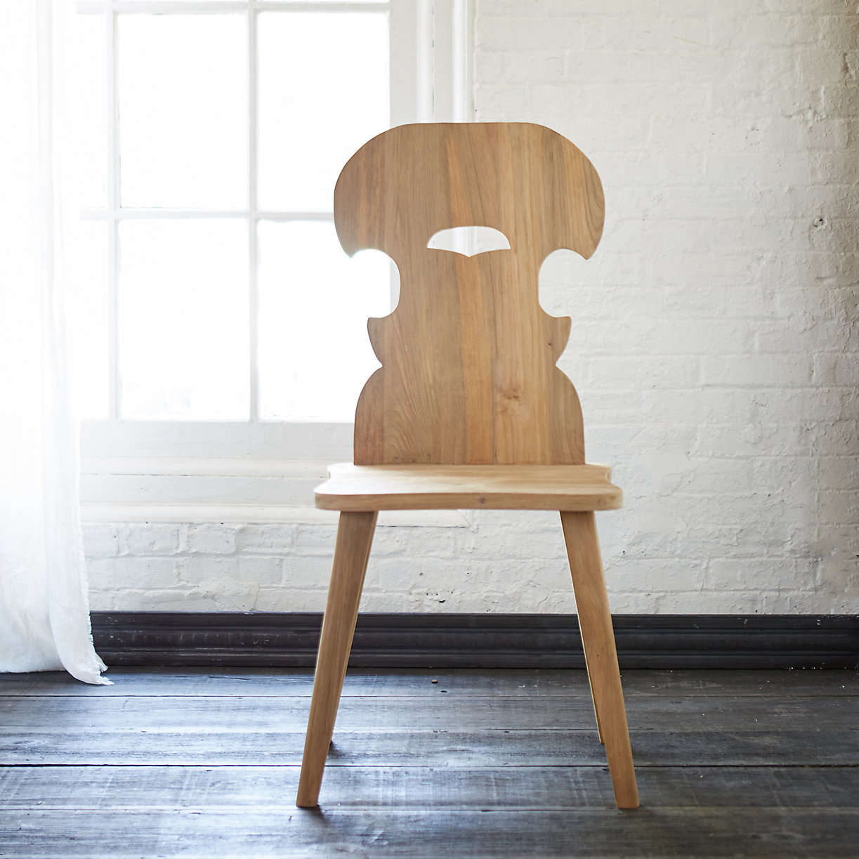 carved teak folk chair terrain 15
