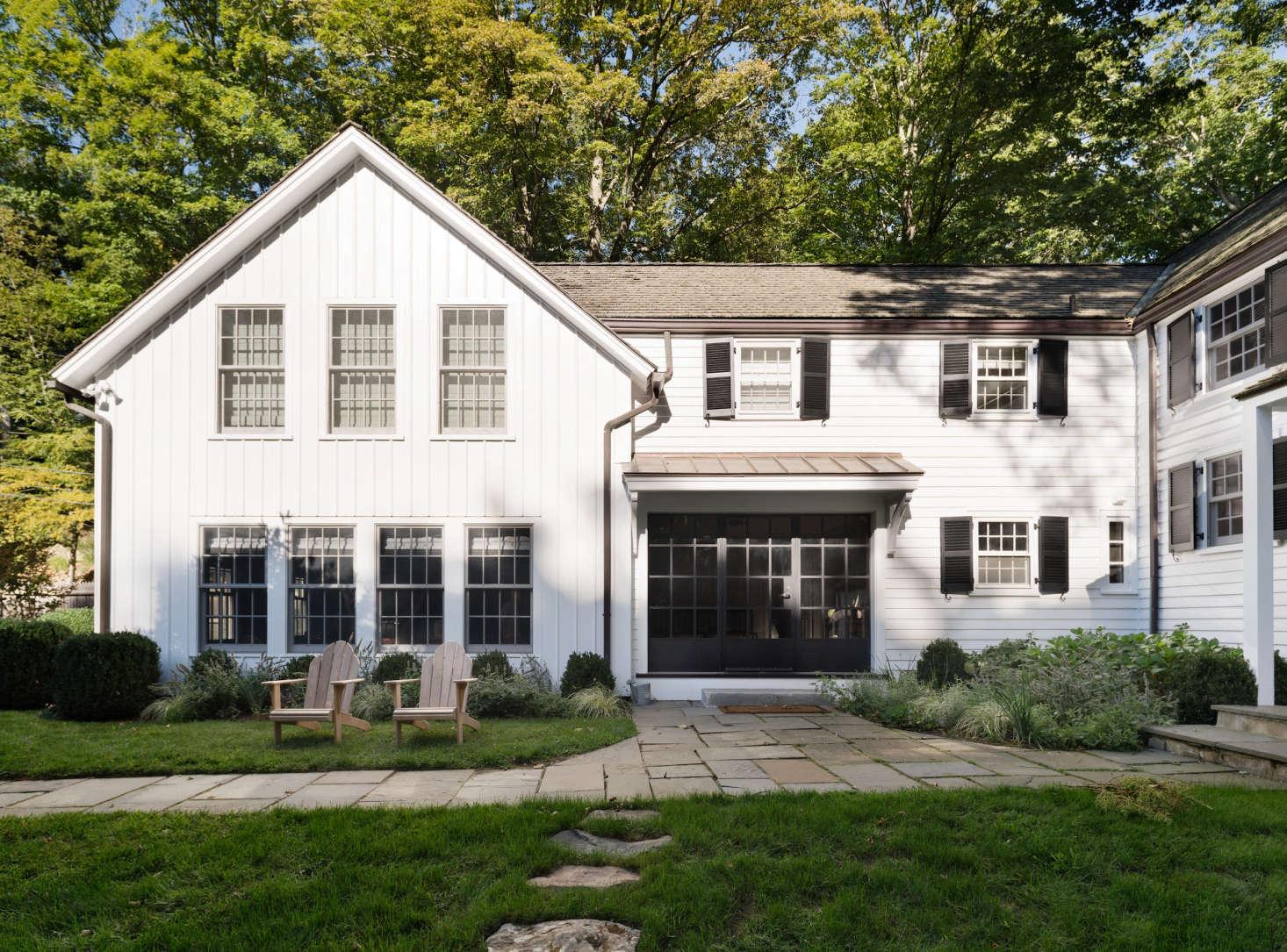 exterior-modern-farmhouse-renovation-white-black-shutters
