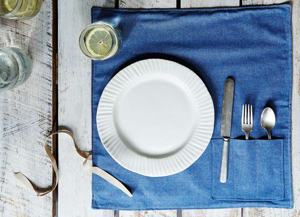 The Denim Flatware Place Setting takes the idea of a knife roll and applies it to the tabletop; $76 for a set of four at Food5
