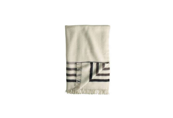 Object Lessons The Hudsons Bay Point Blanket Over the years, colors have been introduced or taken away. This gray scaleHudson&#8\2\17;s Bay Capote Throw is available for \$\165 from Woolrich.