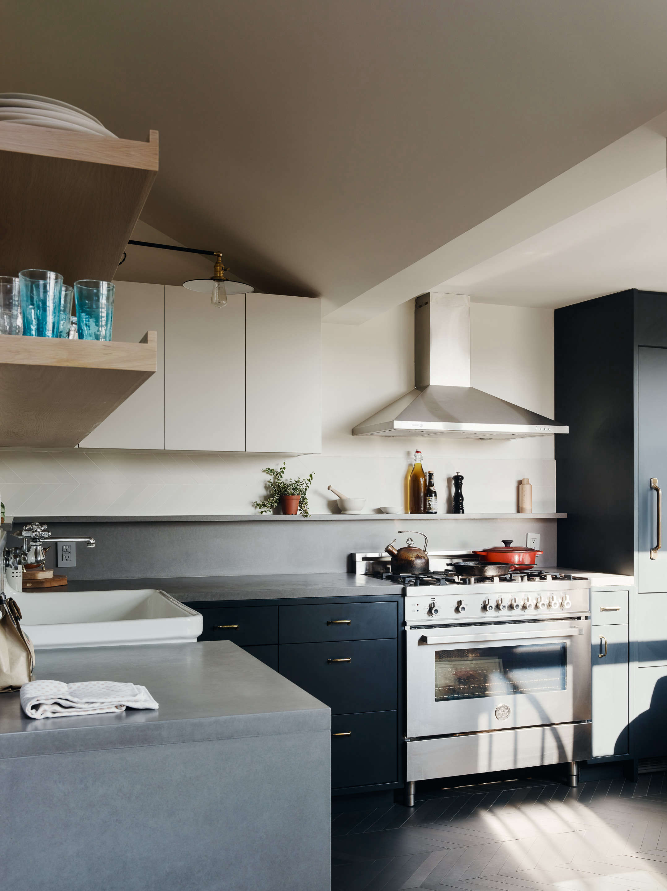 kitchen with dark blue cabinets general assembly