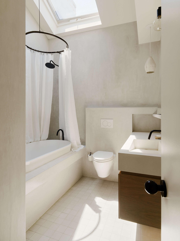 light filled bathroom skylight concrete finish general assembly
