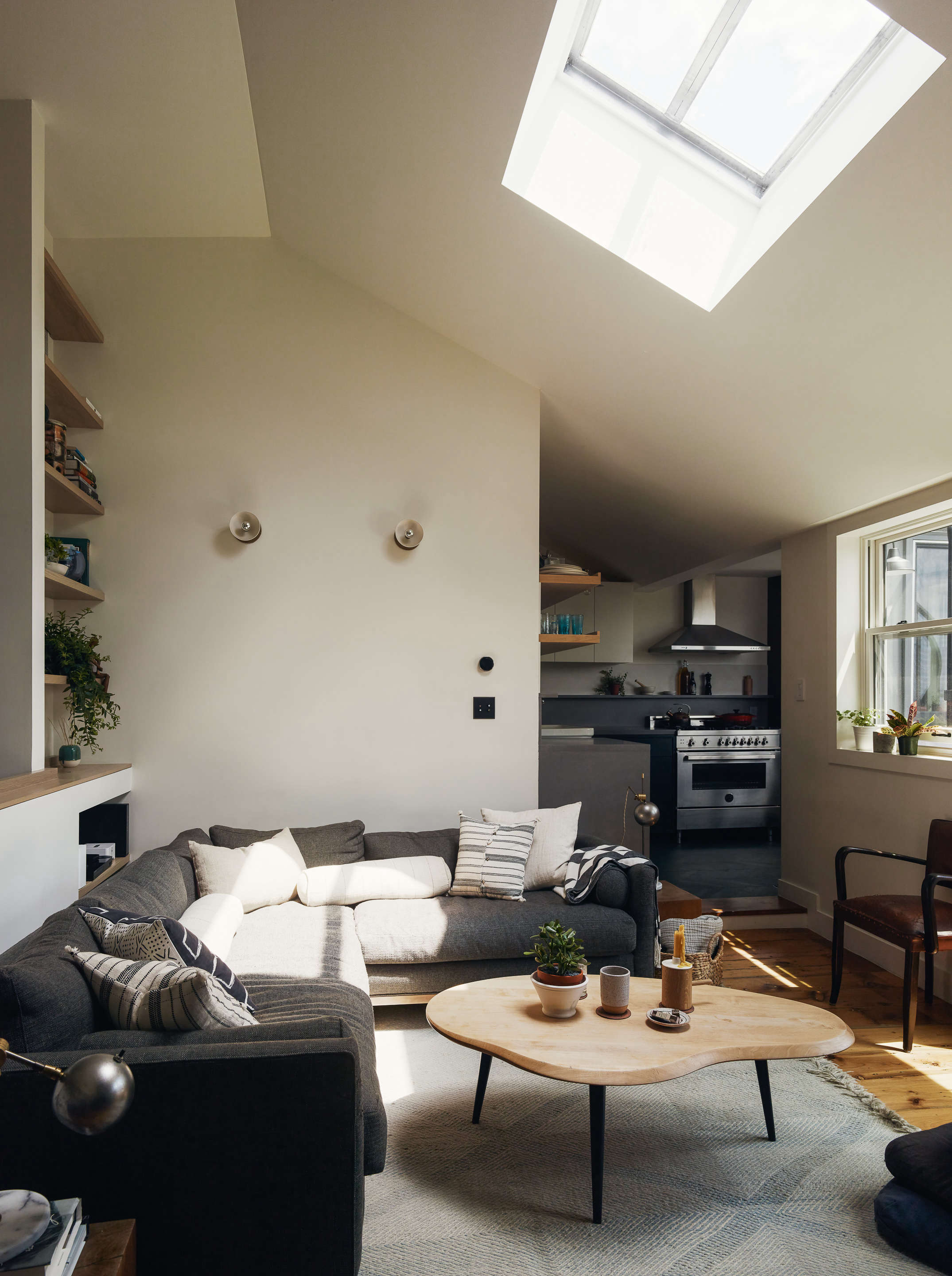 living room with cream white walls and skylight general assembly