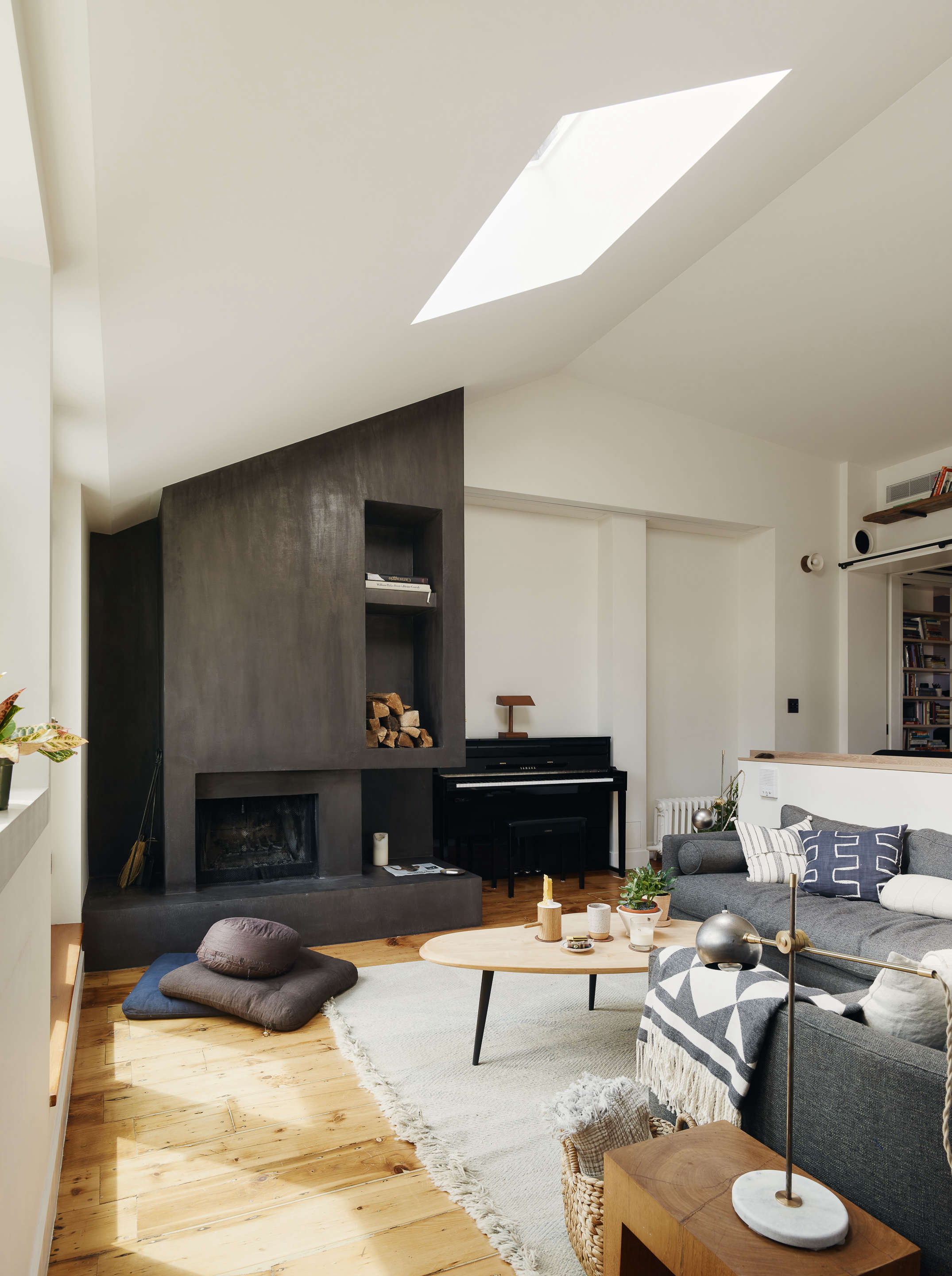 living room with skylight white rug concrete fireplace general assembly