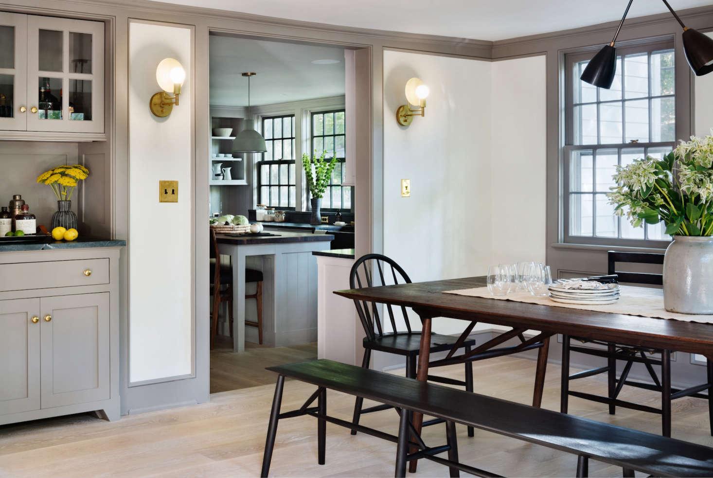 modern-farmhouse-renovation-dining-room-kitchen-brass-sconces-built-in-storage